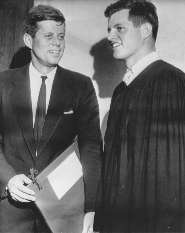 Edward M. (Ted) Kennedy (right) talking with his oldest brother John at Harvard commencement when Ted graduated and his brother, then a senator, received an honorary degree, in 1956.