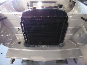1955 Chevrolet Bel Air - Installed the radiator condenser coil, air dryer, electrical wiring for fan and starter.  Integrating the wiring harness.