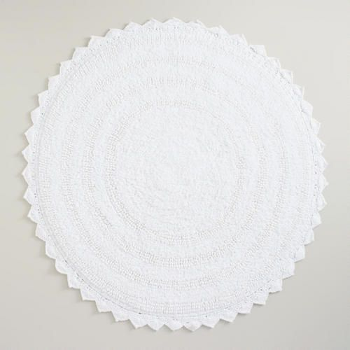 One of my favorite discoveries at WorldMarket.com: White Round Bath Mat-I bought this in gray-love it