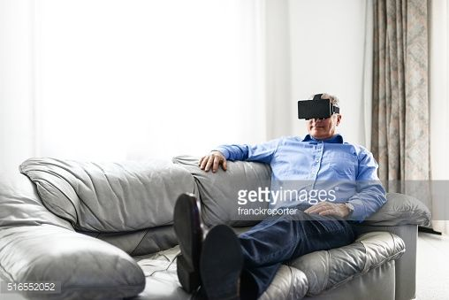 Stock Photo : businessman watching a movie on the couch