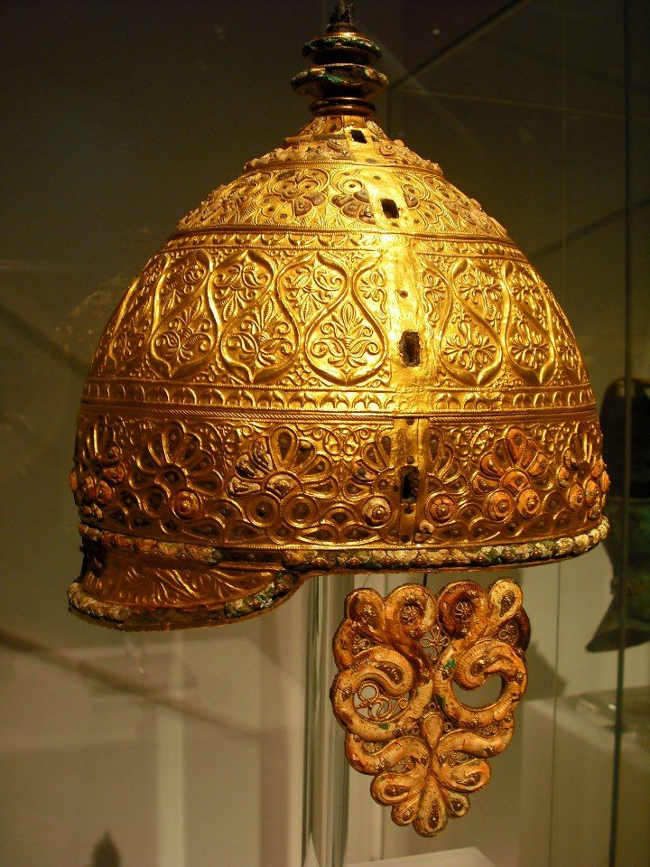 Celtic parade helmet - Agris, France, about 350 BC. This impressive piece of art was buried in a cave in Agris, western France. The entire cap, neck guard and cheek guards were all cluttered with lavish gold tendril and leaf design. Together with the gold, red coral inlays provide an effectual contrast. Art of the Celts, Historic Museum of Bern.
