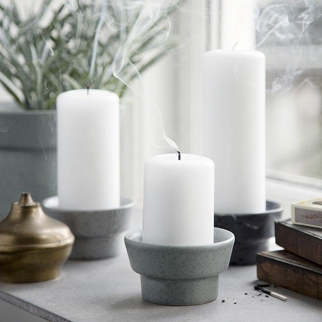 The granite green Ombria pillar candle holder in the popular Ombria stoneware range is embellished with innovative glazes and a simple idiom, which draws inspiration from the rough, wild Scandinavian countryside. The entire Ombria range is glazed by hand to achieve the distinctive surface effect, which consists of a mix of glossy and matt glazes. The range is designed by Danish Anders Arhøj.
