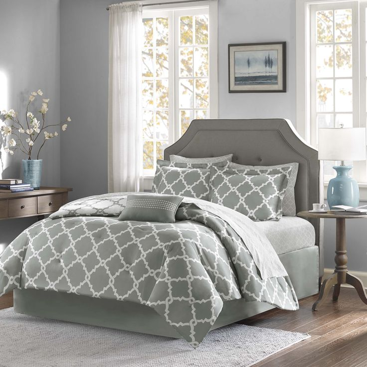 The Madison Park Essentials Almaden Complete Bed and Sheet Set creates a simple yet chic look in your space. The fretwork design creates a modern look with its white design on a soft grey base.