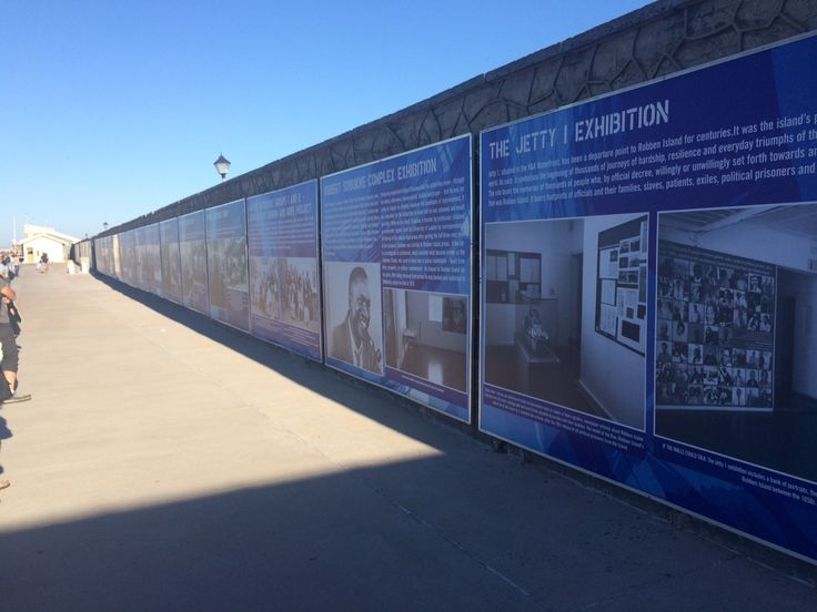 The view of all the posters on the docks at Robben Island
