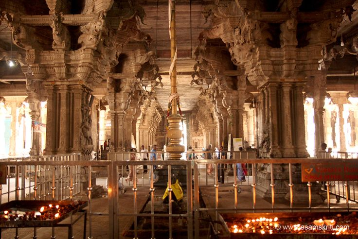"""Huge pillars on 4 sides of flag post. Devotees lit diyas and kept. """"Monolithic stone pillars (made from single stone) are found in the mandapam. Stone chains and 12 zodiac signs are beautifully carved on these pillars."""" Missed seeing the stone chains and zodiac signs. Pillar on left and right that I think Shiva Parvati images, do see that too."""