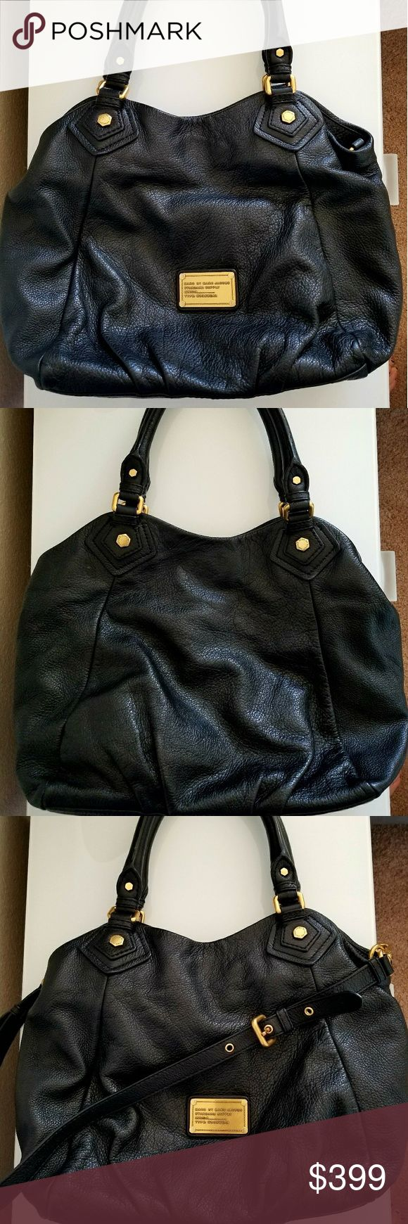Marc by Marc Jacobs handbag Marc by Marc Jacobs handbag in a beautiful black leather. This handbag is great for everyday use. I bought it on shopbop a few years back, and loved to wear it. It comes in great used condition with any scratches. It comes with an additional leather strap to wear it as a shoulderbag. Marc By Marc Jacobs Bags Shoulder Bags