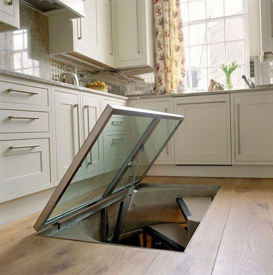 Kitchen wine cellar. This cracks me up, I like wine but not so much that I need an escape hatch to it!
