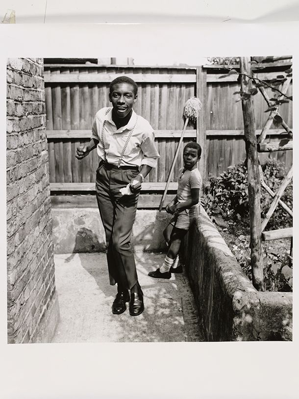 Neil Kenlock, 'Untitled [Young teenage boy who, just arrived from  Jamaica, shows off his latest reggae dance with his younger brother   watching, Brixton Hill]', 1968. Museum no. E.220-2012. © Neil Kenlock/  Victoria and Albert Museum, London. Supported by the National Lottery  through the Heritage Lottery Fund.