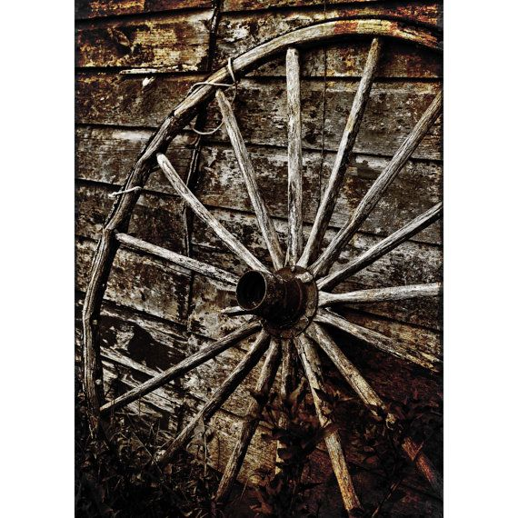 broken wheel from a horse drawn carriage in Amish country