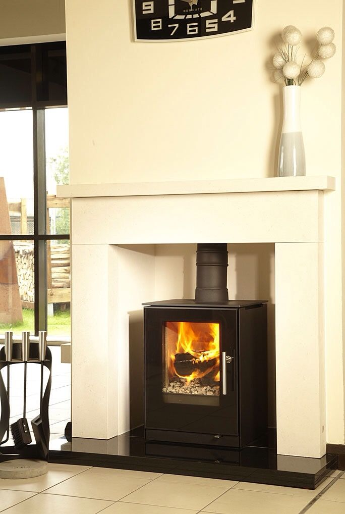 The NEW Rais Q-Tee 57 Wood Burning Stove.  A small, functional, adaptable and simply designed wood stove with a cubist look, Q-Tee is an ideal wood stove for a small room and is DEFRA approved for use in smoke controlled areas.