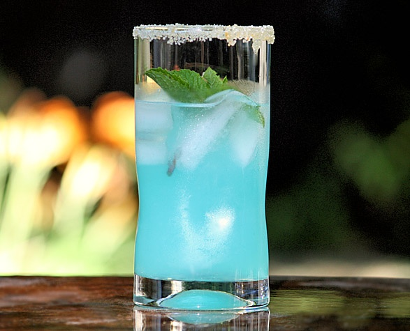 tiffany lemonade:  6 oz. fresh squeezed lemonade  2 oz. peach schnapps  ½ oz. blue curaçao  sugar
