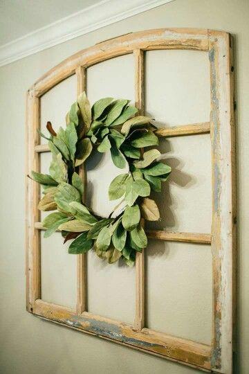 Super cute idea. Love the magnolia wreath on top of that cute window frame!