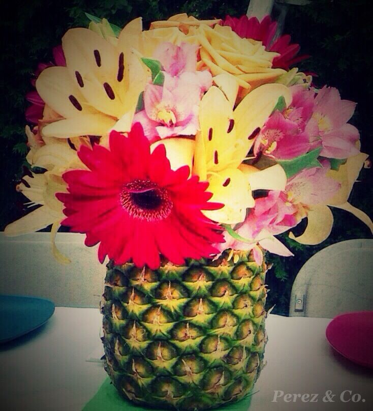 Lilies and Daisy's in a Pineapple Vase. Great Luau Decor - By Cindy Perez for Perez & Co.