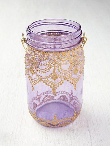 Free People Mason Jar Lanterns  Looks super easy to do yourself, too!  Fabric paint, mason jar, heavy wire.