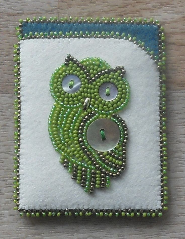 Beaded Card case/holder!!! Beadwork and Abalone buttons on white Melton w/felt lining done by Carmen Dennis (Tahltan)