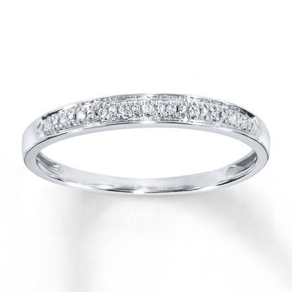 This classic diamond anniversary band for her is accented with twinkling pavé-set round diamonds. The ring is fashioned in 10K white gold.