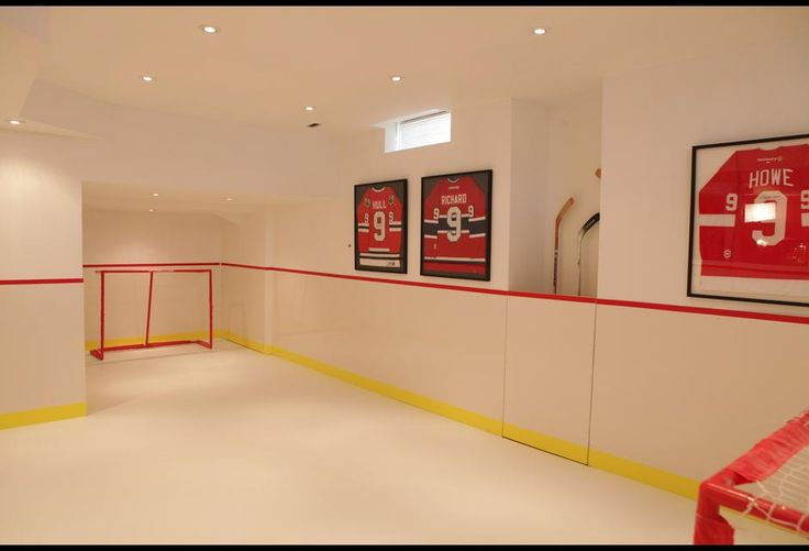 This indoor hockey rink with synthetic ice is the ultimate for Hockey bedroom ideas