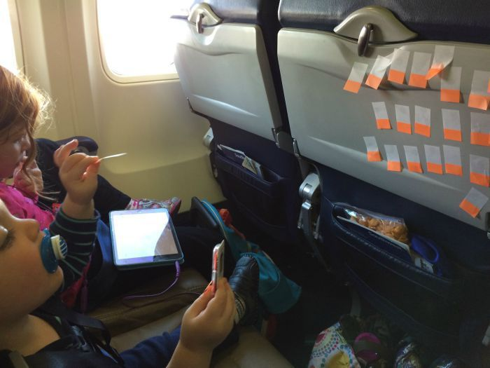 How to Survive Flying with a Lap Toddler Post It Note Games, wikki stick, days of week pill case with goldfish inside,