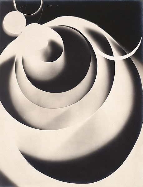 "A Rayograph by Man Ray. Although commonly dubbed the photogram today, there's a pleasant science-fiction flavour to Man Ray's original coinage, the Rayograph. It's basically a photograph created without the use of a camera. Objects are placed directly onto a chemically ""sensitized"" surface and then exposed to light"