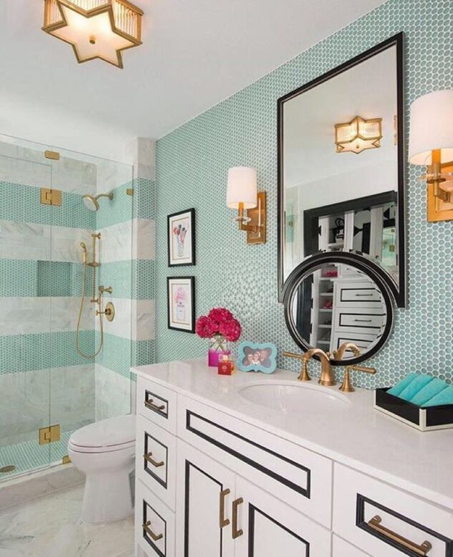 These white cabinets with black detailing and gold hardware are everything  11 Bold and Beautiful Kate Spade New York-Inspired Bathroom Ideas ...