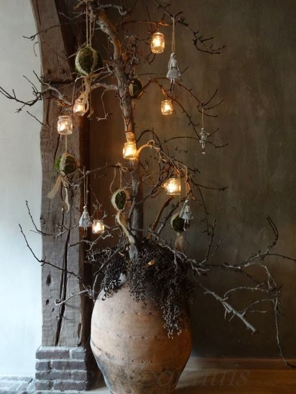 tree made from loose branches, mosballen, lanterns, and doll ornaments