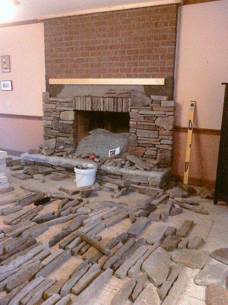 Veneer over old brick fireplace.  Yes, please!!!!