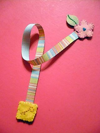 I like this idea but maybe instead of felt I could make a couple crochet ends and sew them onto a ribbon.