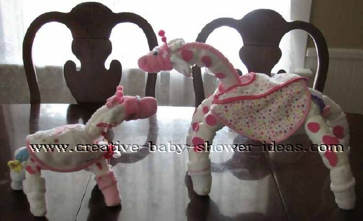 diaper momma and baby giraffes - Karen rolled diapers into arms, legs, necks and bodies and held them together with various sizes of plastic hair bands. Altogether she used 22 diapers, 7 socks, 3 bibs, 4 headbands, 1 pacifier and 2 pairs of butterfly hair clips