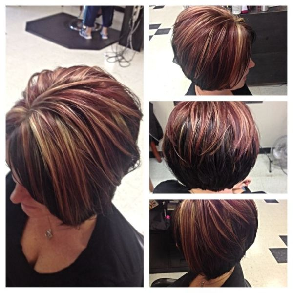Asymmetrical bob by Courtney Curtis and highlights/lowlights. Red, Blonde, dark Brown by suzette