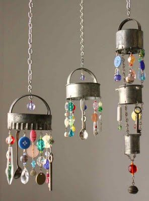 Windchimes made of old kitchen things - cookie cutters, biscuit cutters, spoons,