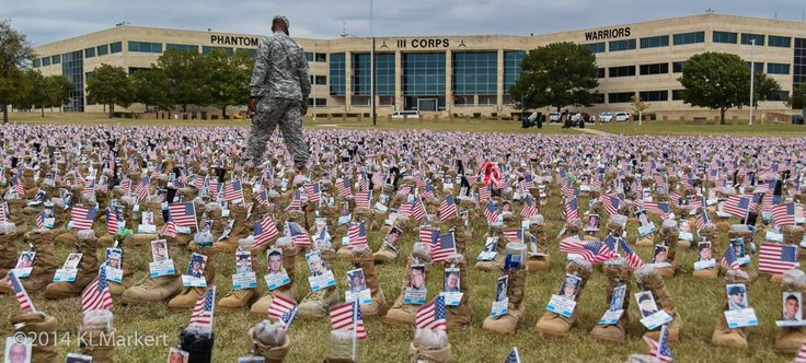 Fort Hood Fisher House Boots - a boot honoring each service member who has fallen from 2001 to 2014. Volunteers have worked long hours on this project, attaching the service members' photos and basic service information to each boot.