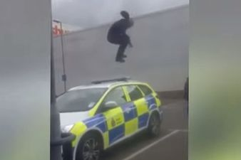 Crazy Man Smashing a Police Car in UK