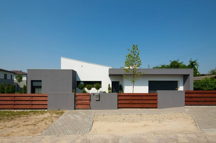 M house by RS+ Robert Skitek, located in Tychy, a city in Silesia, Poland.