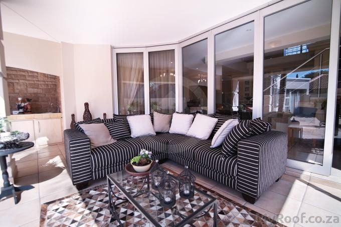 Outside living room / patio flowing out to the garden seen in exclusive estates at myroof.co.za