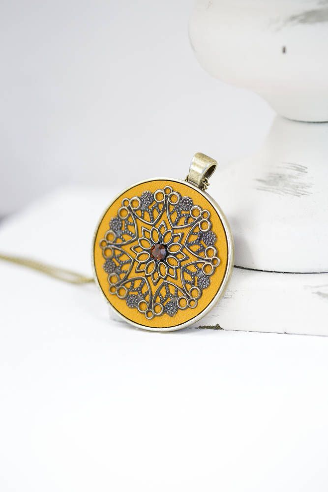 Mustard Yellow Leather Bronze Silver Pendant / Bronze Color Chain by BeautyfromashesUSA on Etsy https://www.etsy.com/listing/549089402/mustard-yellow-leather-bronze-silver