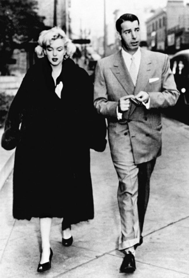 Marilyn and Joe DiMaggio on their way to obtain passports for their visit to Japan, February 29th 1954.