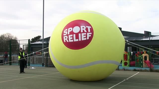 Giant tennis ball rolls through Liverpool for Sport Relief
