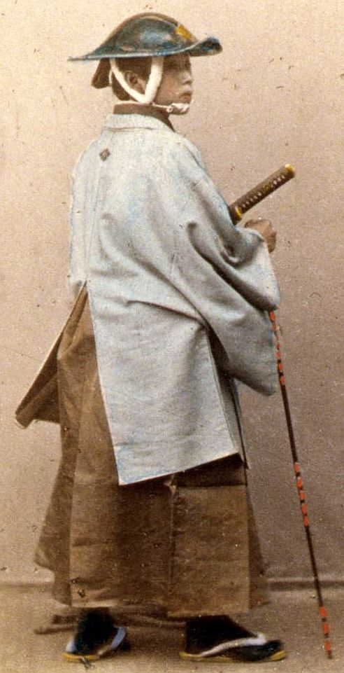 """""""Japanese officer in gala costume"""" Samurai wearing a jingasa and holding a muchi (whip)."""