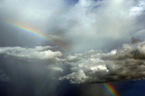 Nieuw in mijn Werk aan de Muur shop: Regenboog achter een donkere lucht met…