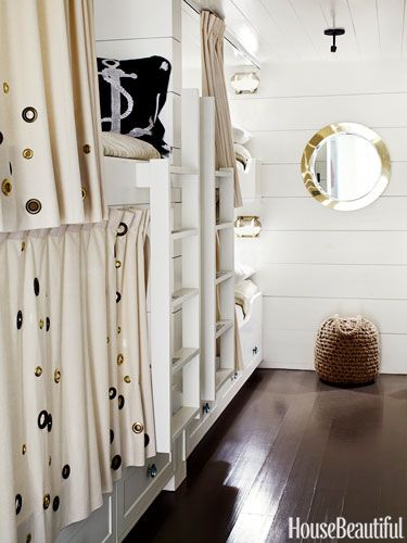 In a California beach house designed by Erin Martin and owner Kim Dempster, the bunk room feels like a ship's cabin and is lined with six bu...