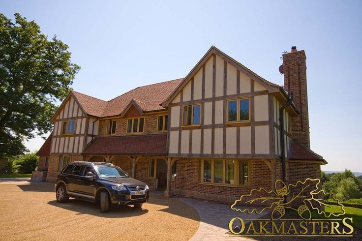 External house cladding - Oakmasters - This hybrid house is build using a combination of masonry, solid oak frame and external oak cladding