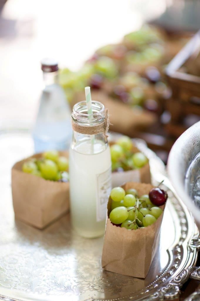 Fresh Lemonade and brown paper bags with fruit on silver vintage tray