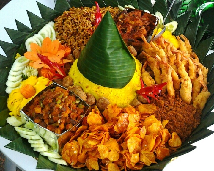Tumpeng Nasi Kuning with various side dishes