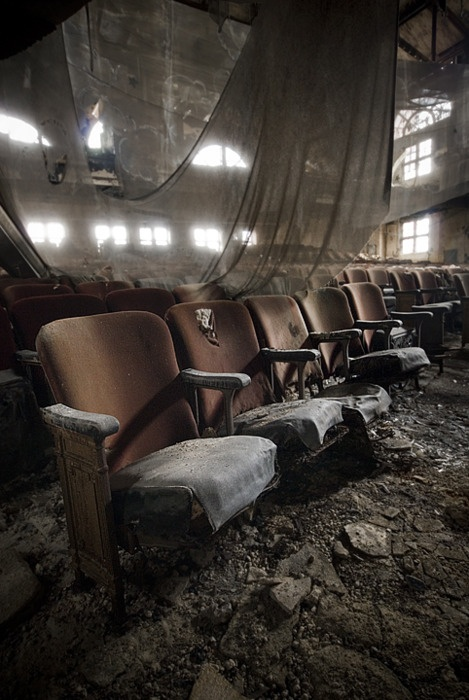 This would be awesome to find a theatre this run-down. I love the hanging drapes that have fallen down. The faded fabric on the chairs is awesome. The flower is a little too dirty, I think. -GG