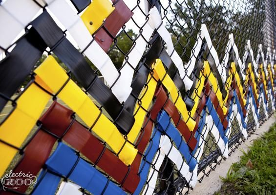 Example of synthetic ribbon used to weave colourful and lively patterns in the fence structure. The resulting artwork could draw people to the construction site and add character to the surrounding streetscape. Why not get the community involved in the weaving process?