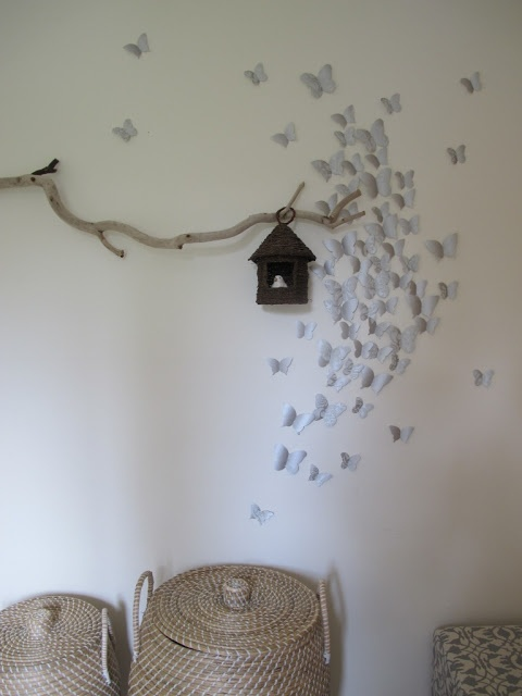 DIY mural: easy 3D butterfly wall decoration made with wrapping paper and a little elbow grease. Great for living room or bedroom.