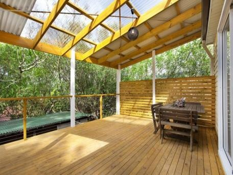 Clear panels in the roof above deck and privacy screening - would look great in our backyard