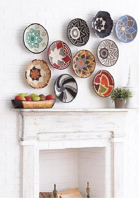 "Wall decorated with a collection of Rwanda made baskets | Image from the ""Rwanda Path to Peace Collection"" available through Macy's"
