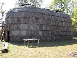 this long house was made by mohawk indians long house and is made of natural materials; wood mostly. they are bent into shape to createthe curved top