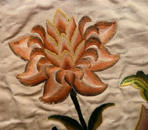 """Satin stitch in silk; detail of an altar frontal, France or Italy, 1730–40. A """"satin stitch"""" or """"damask stitch"""" is a series of flat stitches that are used to completely cover a section of the background fabric."""